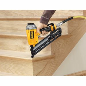 Dewalt finish nailer being used to build stair case