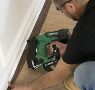 Hitachi Cordless Brad Nailer attaching shoe molding