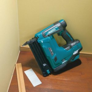 Makita cordless brad nailer leaning against wall