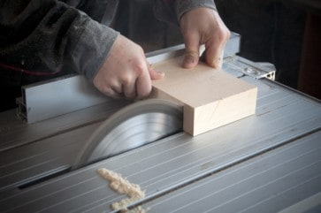 Cutting block of wood on table saw